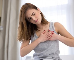 woman in pajamas having heart attack